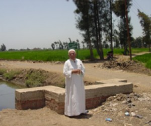 Hag Ahmed Bahgat Ahmed is standing on the covered part of a canal that is now protected from garbage and sewage.