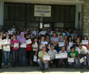 High School students in the town of Ferizaj/Urosevac show their USAID certificates after a year of extracurricular computer and