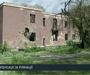 "A snapshot of Valentina's house from the news report by ""Ukrayina"" TV channel."