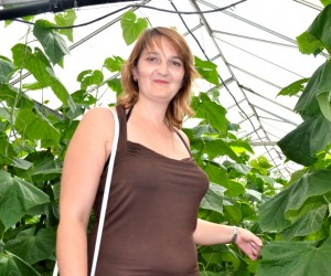 Tatiana Bilscaia, inside a modern greenhouse in Romania during the ACED hydroponic vegetable production study tour.