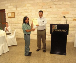 Yuri Tecún receives a diploma from Zamorano authorities after ranking seventh in class.