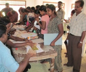 Displaced Sri Lankan citizens apply for replacement identity documents at a USAID-funded mobile clinic.