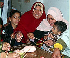 "Literacy learners make educational toys from local materials during a ""Learning Carnival"" in Cairo."