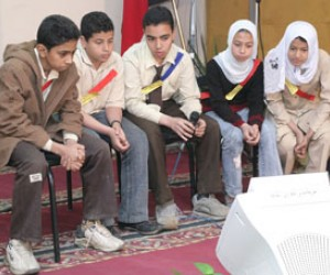 Students read a question during a environmental competition sponsored by a USAID project in Egypt.