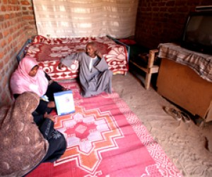 A female outreach worker provides parents with health information regarding the dangers of female genital cutting