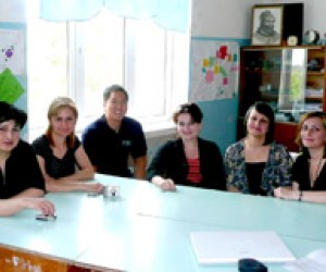 A group of teachers from Public School 17 in Kutaisi, Georgia pose with trainers from USAID's Healthy Women in Georgia pro