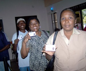 Caisse members display their new biometric ID cards