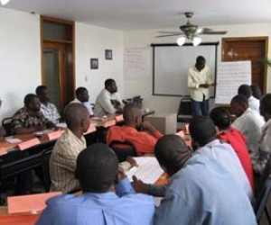 A participant makes a presentation during a portfolio management class at the National Association of Microfinance Institutions