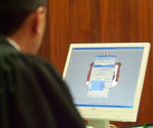 A USAID-supported court automation system enables chief judges to generate monthly court statistics.