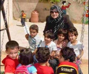Zeinab plays with the children attending her kindergarten in Sakhra, Jordan.