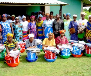 Traditional midwives receive clean delivery kits as they graduate from USAID training in Liberia