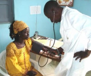 Doctor examining female patient in clinic