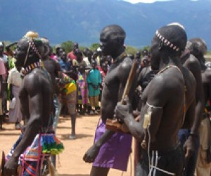 Residents of Kapoeta, Eastern Equatoria, do a traditional peace dance at a rally where the peace agreement text was distributed.