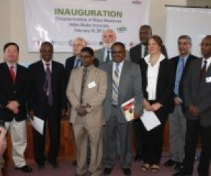(back), U.S. Ambassador Booth, USAID Mission Director Staal, and U.S. Science Envoy Ejeta join representatives and faculty.