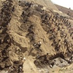 Mountainous ridges surround a village on the outskirts of Ghazni City. Irrigation canals built into narrow valleys near these to