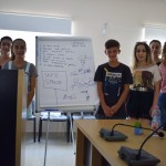 Members of the Cerrik Youth Council standing in front of their poster board.