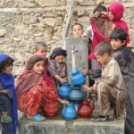 Children in Nawa village in Kunar province collect water from a new tap installed by USAID.