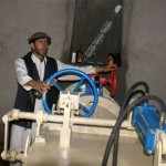 A technician switches on the Dodarak Micro-Hydropower Plant for the first time.`