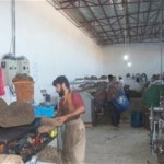 Packing wool at the Ikhlas Wool Spinning Company.