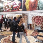 Visitors at Domotex in Hannover, Germany, admired Afghan carpets on display.