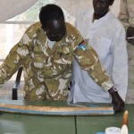Ministry of Wildlife officials work with USAID partners to catalog and test confiscated elephant tusks.