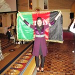 Fereshta Abbasi poses with the flag of Afghanistan at the Philip C. Jessup International Law Moot Court Competition in D.C