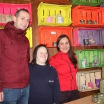 Businessowner Irma Zerdo, right, with employees Edin Islamović and Berina Zerdo, in front of Cvetak's display of herbal teas