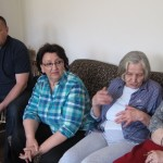 Tenants of Tesanj in Bosnia and Herzegovina converse comfortably inside a warm apartment.