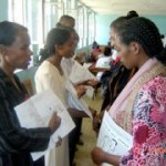 Elfinesh Duko (front left) explains the contents of the family health card to new volunteer community health workers.