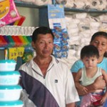 Blanca, Alberto, and one of their sons at their newly opened shop.