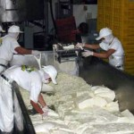 Employees process cheese at Agroindustrias San Julian plant.