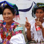 K´iche´maya women show their inked fingers after voting.