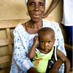 Fatta Mento is raising grandson Febyah in Lofa County Liberia and attends USAID nutrition classes in her village.