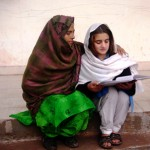 A student reads to Gul after school in Dharian Bambian.