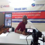 A man gives a conference while he is being recorded live on Facebook
