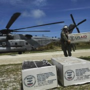 Aid is unloaded from a US helicopter in Jeremie, southwest of Port-au-Prince, Haiti