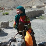 A girl retrieves water at a nearby water source in rural Morocco.