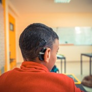 Hard of hearing student participates in an activity in Moroccan classroom