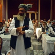 Afghan elders, under a USAID program, meet to share challenges and best practices in traditional dispute resolution and to colla