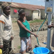 "Tenants in Nakuru enjoy the convenience and affordability of using public prepaid meters. Jane Maina was one the first landlords"" title=""Tenants in Nakuru enjoy the convenience and affordability of using public prepaid meters. Jane Maina was one the first landlords to sign up for the installation of public prepaid meters in her compound with 43 houses. All her tenants immediately signed up for the token that gives them access to clean and affordable water."