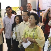 USAID Deputy Administrator Donald Steinberg, right, views an exhibit highlighting the environmental partnership between USAID an