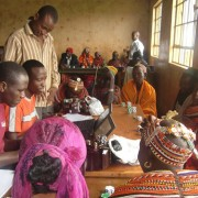 Kenyan pastoralists learn about livestock insurance.