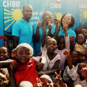 Sanergy hosts a marketing event in a Kenyan community to generate demand for its low-cost, hygienic sanitation centers. The toil