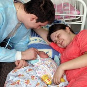 Natalia and Alexei Voinerovsky are enjoying the company of their newborn son in a postpartum ward of the Oblast Hospital