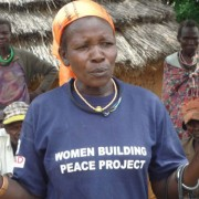 A peace committee member speaks to a group about early marriage and education for girls in Napak district.
