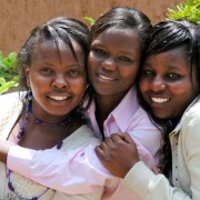 Carole Nyamoita, center, has known friends Elizabeth Njeri, left, and Cathy Magio since high school.
