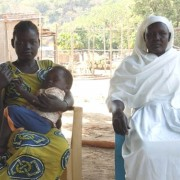 Suzanna Ile and her son Modi at the USAID-supported Lokiliri Primary Healthcare Centre, with the community midwife who helped en