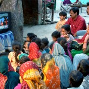 Reading, a by-product of entertainment: community viewing of Bollywood film songs with same-language subtitling in Gulbai Tekra