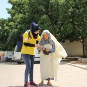 Election monitor with Tunisian voter