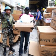 The International Office for Migration distributes aid on Feb. 18, 2010, in Port-au-Prince, Haiti. More than a million people we